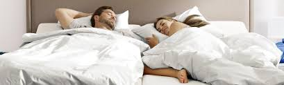 full size mattress two people. Photograph Of Man And Woman Smiling On Bed Full Size Mattress Two People