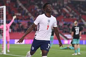 Lettering in blue paint was daubed over the black and white. England Stars Raheem Sterling And Marcus Rashford Told To Watch Out For Bukayo Saka As Gareth Southgate Heaps Praise On Arsenal Man Ahead Of Euro 2020