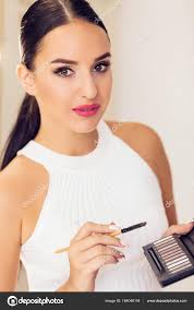 professional makeup artist to do new style stock photo
