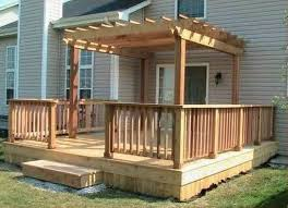 captivating covered small deck designs ideas with wooden railing fence and wooden pergola roof also white frame glass window