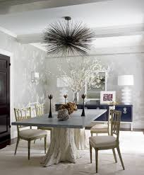 in ashley stark kenner s dining room designed by james aman and john meeks cowhide cut into squares and sched into a large carpet lays the groundwork