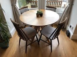 john lewis walnut radar 4 seater round dining table 1 year old and vintage