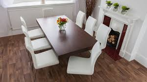 6 8 seater floating dining table and faux leather dining chairs