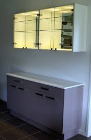 stone top sideboard with overhead cabinet with feature spotlights glass door and rear mirror mike design