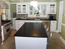 Flooring Choices For Kitchens Kitchen Brown Tile Flooring Brown Base Cabinets Stainless Wall