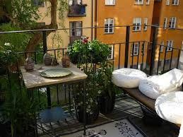 apartment balcony furniture. Attractive Apartment Balcony Furniture With Wooden Bench And Square Table Plus Awesome Plants Modern White