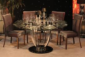dining room curving silver steel with round black base combined with round glass top also