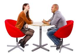 people sitting at table white background. interracial couple meeting for the first date : stock photo people sitting at table white background