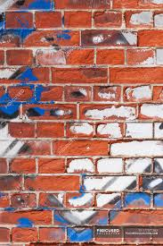 old brick wall with remains of graffiti stock photos