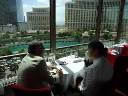 dining with eiffel tower view. joung sohn and elv dining with eiffel tower view