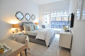 Restoration Hardware grey bedding with touch of blue and white; campaign  side tables and bed