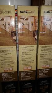 trafficmaster 5 45 64 in x 35 45 64 in x 4 mm rustic maple honeytone vinyl plank flooring 67 98 sq ft 45 00 all three boxes
