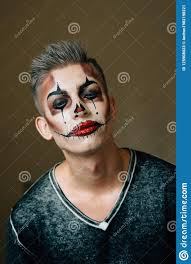 handsome guy with a clown makeup on his face