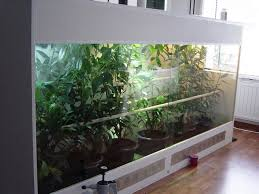 a large terrarium designed to keep larger chameleon species note the ventilation ports at the bottom below the doors photo courtesy of steven oosterhoff