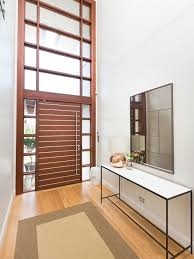 entryway designs for homes. photo of a contemporary entryway in sydney with white walls, light hardwood floors, designs for homes b