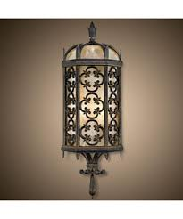 shown in wrought iron finish and subtle iridescent textured glass glass