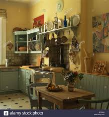 Old Fashioned Kitchen Old Pine Table And Chairs In Old Fashioned Yellow Kitchen With