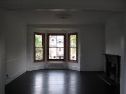 painting wood floors black