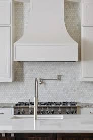 Small Picture White Kitchen Cabinets with Oblong Marble Tiles Transitional