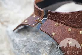 neck guard armor gorget bird of prey available in stainless brown veg tanned leather black veg tanned leather red veg tanned leather green veg