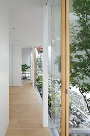 Glass Sliding Walls House With Floating Facade Glass Walls And Interior Courtyard