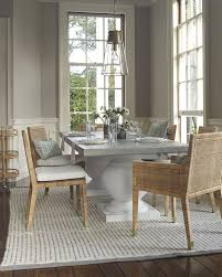 a luxurious dining room terrace dining table and balboa chairs via serena lily