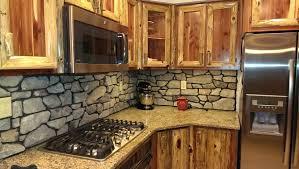 Rustic Red Cedar Kitchen with cultured Stone Backsplash rustic-kitchen