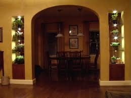 lighted glass shelves surround archway
