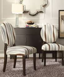 showcasing round backs durable rubberwood construction and room friendly print these chairs provide your dining room with elegance