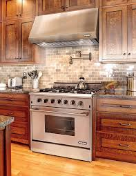 Big Ductless Range Hood With Dark Wood Cabinets And Wood Kitchen Island  Plus Ceiling Lighting Also · Modern Kitchen Design Ideas ...