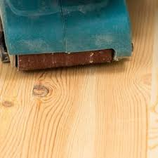 photo of hardwood floor refinishing vancouver bc canada hand sander in action