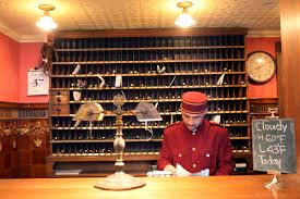 a man works at the front desk of a hotel