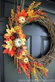 Twine, cinnamon, and dried oranges can help create some gorgeous artwork as  seen above. Learn how to make this wreath at Artsy Chicks Rule.