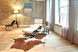 cowhide rug smell architecture attractive pad home design ideas black pertaining to faux in renovation ikea cowhide rug