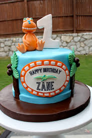 Dinosaur Train Cake And Cupcakes Layered