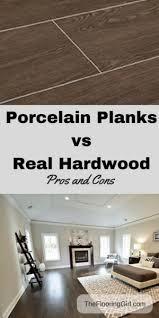 Wood floors in living room Mahogany Solid Hardwood Vs Porcelain Tiles That Look Like Wood Pros And Cons The Flooring Girl Hardwood Flooring Vs Tile Planks That Look Like Hardwood Pros And