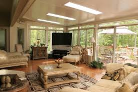 modern sunroom furniture. Aluring Sunroom Decorated With Wooden Flooring And White Wall Paint Using Glass Windows Sets Plus Modern Furniture