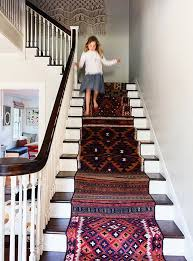 layering rugs turkish stair runners by christine lennon via one kings lane