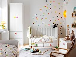 A Small Childrenu0027s Bedroom Furnished With A White Crib With Floor Drawers,  Converted Into A