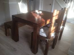 solid dark oak farmhouse dining table with 2 chairs and a bench seat