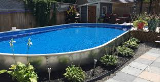 inground pools. Semi-Inground Pools Are A Specialized Pool - Borrowing Their Design Partly From The Above-ground Market While Also Being Dug Down Partially Into Inground