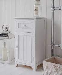 A Crisp White Freestanding Bathroom Storage Furniture A Narrow Bathroom Cabinet Bathroom Furniture Storage Freestanding Bathroom Storage Bathroom Freestanding