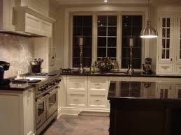 off white kitchen cabinets with black countertops. DIY Antique White Kitchen Cabinets Off With Black Countertops