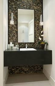 mini pendants pack a lighting punch in this powder room that rocks photo credit