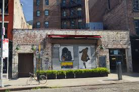 things to do in new york city photo of some closed stores and a bicycle in the meatpacking district of new york city