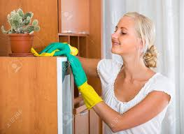 dusting furniture. Cheerful Blonde Woman In Rubber Gloves Dusting Furniture At Home And Smiling Stock Photo - 57835465 G
