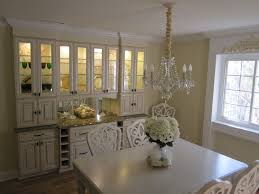 dining room walld ecor with built in cabinet in white combined with marble countertop for