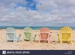 adirondack chairs on beach. Pastel Colored Adirondack Chairs On Love Beach In Nassau, Bahamas S