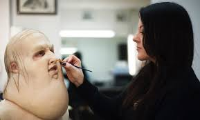 sarah pickersgill working on make up for the devil with the yellow eyes