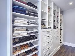 white walk in closet with shaker drawer fronts